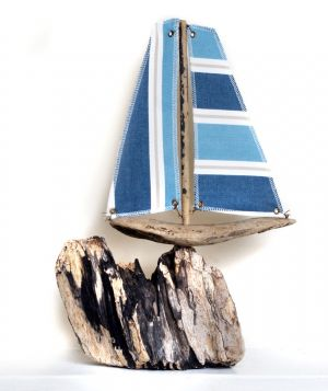 Driftwood Boat On A Rock